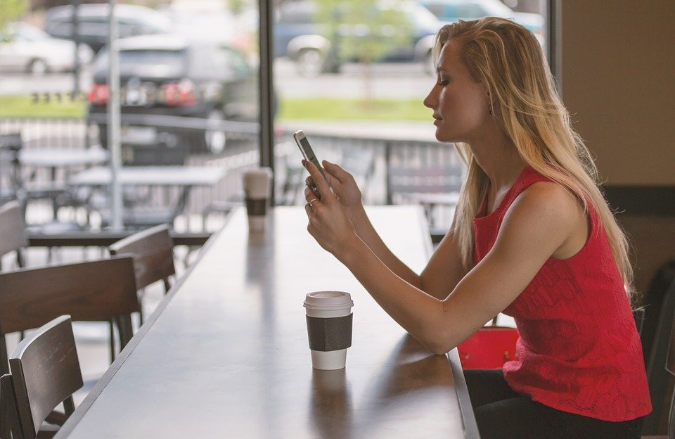 women with phone counter