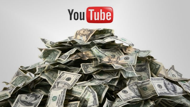YouTube Logo on top of a pile of money