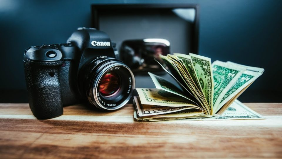 Cannon camera and dollar cash