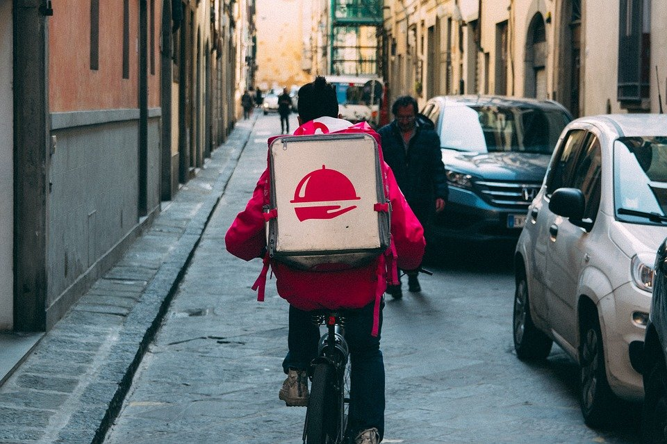 delivery boy riding on his bicycle