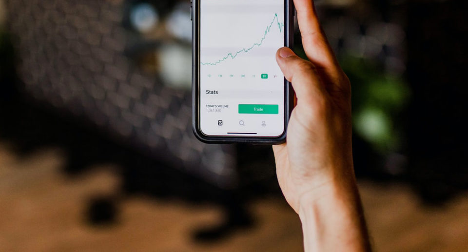 An investor views a stock chart on a mobile device