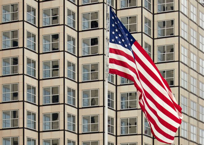 American flag over luxury apartments