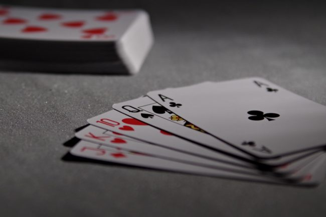 Deck of playing cards with hand face up.